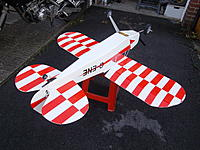Name: IMGP1771.jpg Views: 148 Size: 301.7 KB Description: 6mm depron covered in white packing tape with red trim. All up weight 1.5 kg