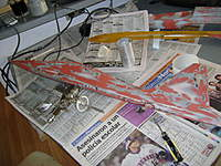 Name: DSC00301.jpg Views: 229 Size: 52.1 KB Description: Luego de un baño de 30 minutos se nota el acabado del fuselaje con las zonas rojas que rellenan las ondulaciones y alisan la superficie