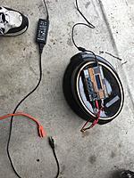 Name: 2EC3F566-4442-447A-B238-01931D941B97.jpg Views: 40 Size: 4.86 MB Description: Charging setup on garage floor. Charger & battery rest on upside down ceramic crockpot