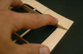 Start gluing the ribs at the trailing edge, then move to the