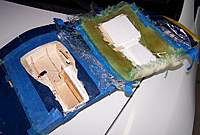 Name: 100_2004.jpg Views: 113 Size: 85.4 KB Description: Immediately after I pried off the mold.  You can see it pulled out all the foam, along with some of the balsa sheeting.