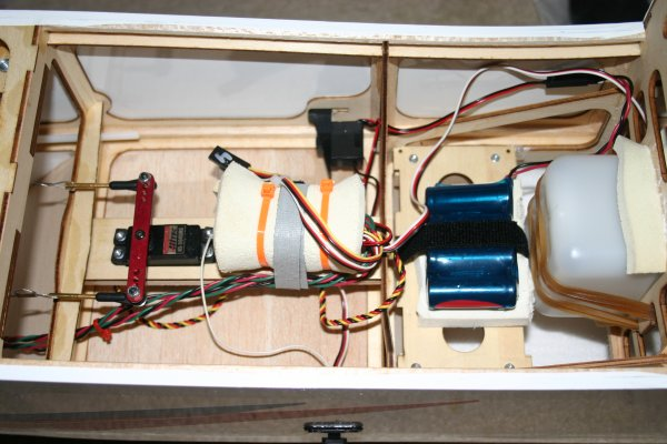 Name: 8.jpg Views: 678 Size: 55.8 KB Description: There was an addendum that came with my instructions for users installing a glow engine. They provide and additional battery tray to glue in behind the fuel tank to mount the battery and receiver. I put my battery (1800 NIMH 4.8 volt)on it, but I mounted