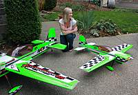 """Name: IMG_1180.jpg Views: 2133 Size: 127.0 KB Description: On the left is the EG Aircraft 50cc 89"""" MX2, in the middle is my lovely soon to be wife, and on the right is a prototype EG Aircraft 58"""" 50e MX2 that I built for EG Aircraft and Azhar @ Aztech Aeromodels"""