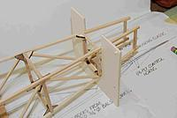 Name: FuseFrame06A.jpg Views: 231 Size: 101.4 KB Description: Since the tail is in midair I made a similar jig for the rear framing, using a machinists square to align the sides with the plans.