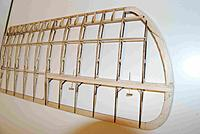 Name: WingUpper05A.jpg Views: 215 Size: 141.2 KB Description: The tips are a 3x lam of soft 1/16 balsa, with ea lam cut in (3) sections so that the grain of the wood can be used to advantage.  The joints in the ctr lam were offset from the upper and lower lams.