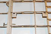 Name: WingStrut04A.jpg Views: 175 Size: 129.2 KB Description: Over the slot fittings attd at the corner where spar and rib meet is a ply cover to accept rigging.  These must be flush with the wing surface.