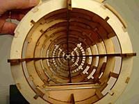 Name: InsideA.jpg Views: 128 Size: 156.0 KB Description: Although shown here partiall sheeted/stringered and the frame removed this is what the fuse should look like - the slots for the frame are at 45 deg in ea quadrant.