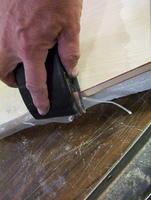 Name: 100_7416.jpg Views: 121 Size: 96.3 KB Description: Trim excess fiberglass cloth with 400 grit sandpaper.