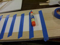 """Name: 100_7734.jpg Views: 130 Size: 73.9 KB Description: Blue painters tape holds the """"capstrips"""" in place while the glue dries."""