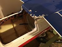 Name: image.jpg Views: 48 Size: 616.4 KB Description: The damage to the fuselage caused by the shed fan blades.