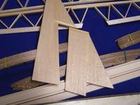 Name: 100_0822.jpg Views: 227 Size: 63.6 KB Description: Fin and rudder.  These are pretty straight forward in construction.  Sheet stock provided, cut to shape and glee.  Add spruce strips and sand.