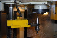 Name: DSC_0845.jpg Views: 334 Size: 78.0 KB Description: Tool change arm swings to spindle, and removes tool