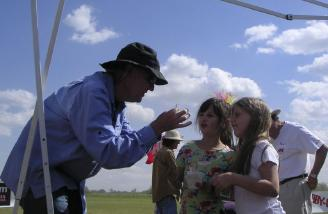 A magician entertains some of the younger attendees