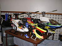 Name: My helicopters Oct 2010 002.jpg Views: 153 Size: 96.0 KB Description: The Magnificent Seven   Listed from smallest to largest MSR,Blade 400, Trex 450 Pro,Trex 500 ESP, Century Hawk Pro OS37 Heli w/ Align Governor a work in progress ,Trex 600 NSP W/600 LE Metal head , and My Century Predator Gasser . Not shown in the picture