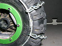 Name: TireChainPics 005.jpg Views: 192 Size: 113.4 KB Description: Detail of the sizing loop. This is a key element in the design. It's lower profile than using chain links so the stearing linkage doesn't catch....also sizing the chains just right is a bitch if you are trying to split and re-attach individual links.