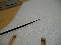 Name: IMG_0294.jpg Views: 306 Size: 121.9 KB Description: I use strips of CF for minor spars. Just slit the foam with your xacto, slide in the CF strip, and then finish it off with a bead of foam safe CA.