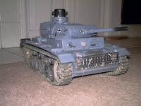 Name: PnzrIII with low profile DBU.jpg Views: 153 Size: 54.1 KB Description: Panzer III Notice the road wheel repairs this baby can run throught 3 inches of water and manouver with the best of them!