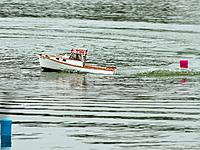 Name: 2012-08-05_055.jpg Views: 54 Size: 295.3 KB Description: The club's boat, Sea Fox, helmed by CaptLee, on the course.