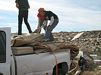 Name: IMG_1847.jpg Views: 101 Size: 107.9 KB Description: Laying out the carpet at the new landfill location.