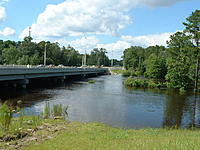 Name: DSCF0012.jpg Views: 39 Size: 202.1 KB Description: Shooting from south side Bridge Span of Town's Rual Divided HWY. Flood Waters Edge to Bushes used to be Dry Glassland...