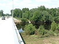 Name: DSCF0081.jpg Views: 46 Size: 230.0 KB Description: Grass & Scrubs Still Show Signs of Flood Water Flow, Debris in Creek...