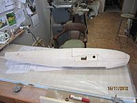 Name: fitted hatch1.jpg Views: 112 Size: 115.8 KB Description: Hatch installed with front dowel pin, sanded to blend with fuselage.