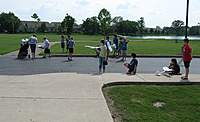 Name: flylite1.jpg Views: 420 Size: 73.2 KB Description: This is the only picture I can find of the finished Flylites...right before our first flights.  Our young pilots are walking out to our flying field...right behind our elementary school.  Is that a lake I see?  (More on that later...)