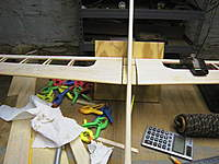 Name: AUT_0405.jpg Views: 92 Size: 59.9 KB Description: Squared up in the jig to cure,the plane is ballast to hold it all in line until cured.Once it cures the bushings will be sanded to close the gap.