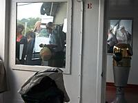Name: 100_5167.jpg Views: 17 Size: 390.1 KB Description: Captain Curtis in the aft pilothouse guiding Badger into the slip.