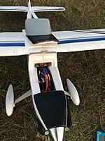 Name: EA3B375C-8713-47B0-AC88-C880273CEA82.jpg Views: 4 Size: 3.86 MB Description: Top battery hatch works fine.  Front tab and aft latch keep her from separating from the fuselage.   Lots of space for battery latching and connecting/disconnecting.    This is the 3200 4S Kinexsis pack from Horizon.