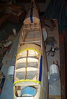 Name: 3-2-12 HatchCover-Turtleback (4).jpg Views: 138 Size: 69.4 KB Description: On to the hatch access.Wax paper first. Lay stringers and formers out just the the height less skin covering