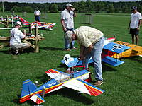 Name: me and my yak   my brother in the background.jpg Views: 193 Size: 139.8 KB Description: At our club's annual show doing a little preflight