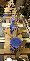 Name: 15-Gluing jig strips to base.jpg Views: 578 Size: 115.8 KB Description: Second jig strip being glued down; formers are only being used as spacers and have not yet been glued into position. Cans are filled with lead shot. Push sticks and saw inserts were convenient!