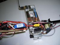 Name: 100_1051.jpg Views: 406 Size: 71.5 KB Description: The little voltage regulator just below the vid tx is from dimension engineering. 3.3V for the RCV922 camera