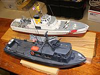 Name: DSCF7736.JPG Views: 11 Size: 372.0 KB Description: My little boat builds.  Revell PCF Swift and the Lindberg USCG Cutter.