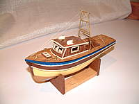 """Name: DSCF0003.jpg Views: 93 Size: 60.4 KB Description: Micro Glass 9"""" hull used in this fishing boat"""