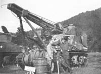 Name: TANK8.jpg Views: 371 Size: 59.6 KB Description: The recovery vehicle that was attached to the unit.  A converted M3.