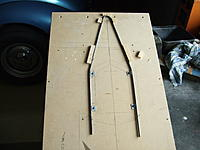 Name: DSCF8009.jpg Views: 159 Size: 149.6 KB Description: the jig...the pieces of steel with the screws in are the main mounts to the ply bulkhead.these will have  3mm bolts through later.The main wing bolt  mount is to go in  the hoop at the top.