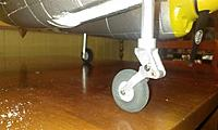 Name: IMAG0142 (Medium).jpg Views: 74 Size: 102.0 KB Description: Nose wheel up close - I had to put a small bolt and nut on yesterday to lock the suspension to give the props clearance.  I intend to lengthen the leg this week somehow (have some ideas)