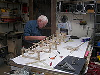 Name: 100_4283.jpg Views: 517 Size: 197.4 KB Description: Here is dad putting in stands to keep it square and straight while turned over. then put on the other half of the formers and start stringers