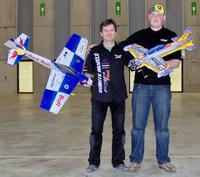 Name: Mons_finalists.jpg Views: 334 Size: 133.6 KB Description: The winners after the final. Benoit Dierickx with a rather heavy plane remarkable for his now traditional variable thrust vector system and Donatas Pauzuolis with the very same SULtimate he flew in Prague last January.