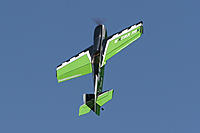 Name: 6984506140_ee63e0939d_b.jpg Views: 80 Size: 215.0 KB Description: A Precision Aerobatics Extra MX, in her favorite position - about $900, and runs $80 batteries.