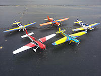 Name: 7524227224_8477e99e52_k.jpg Views: 88 Size: 240.3 KB Description: Other Electric racer planes - two Pogos, my Shoestring, a Hanger 9 Sundowner (red in front), and a custom-built EF-1 spec plane (orange in back) - these are all about $500 all up, and they run a $60 battery.