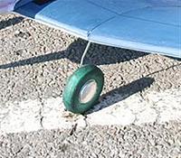 "Name: Wheel hubcap.jpg Views: 49 Size: 55.8 KB Description: Hub cap from a drinks can, tire from a foam kneeling pad. 4"" diameter."