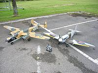 Name: July12 2012 (1).jpg Views: 290 Size: 124.5 KB Description: Two big planes, but one fairly small car.