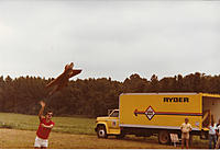 Name: Mig contract qualification F16_1983.jpg Views: 58 Size: 546.6 KB Description: Me hand launching an F-16 carrying a 5# test load.  The spec was 20 flights without repair, landing on a gravel surface. By the 19th flight the entire belly was ground away. After the 20th landing the 5# steel bar payload was falling out.