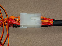 Name: Harness-2.jpg Views: 210 Size: 180.0 KB Description: Close up. V+ & Gnd pass through on 4 wires to/from the receiver/OSD.  Seperate 5 volt supply available on a JST connector.  Not shown, but comes in on the right side.