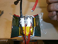 Name: 002.jpg Views: 211 Size: 635.2 KB Description: Top of the pack sliced open to access the tabs. Note how short the soldered part of the leads are.