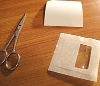 Name: 09.jpg Views: 29 Size: 106.1 KB Description: 09: With a pair of scissors, you are going to cut the non-stick backing you removed in step 07. Cut 3 small strips that will be used to prevent the servo cover from sticking on the wing in a later step.