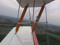 Name: bipes 016.jpg Views: 635 Size: 34.6 KB Description: Post takeoff. Good shot of the windspeed indicator and wingwires.